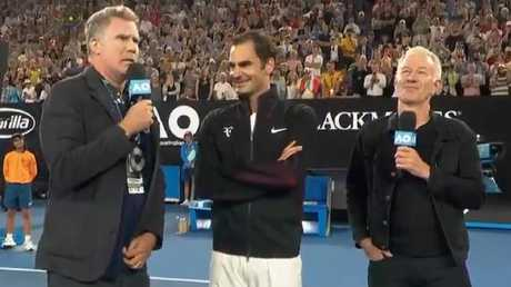 Will Ferrell interviews Roger Federer and John McEnroe on court at Melbourne Park.