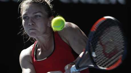 Romania's Simona Halep makes a backhand return. Picture: AP