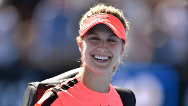 Canada's Eugenie Bouchard celebrates her victory against France's Oceane Dodin during their women's singles first round match on day two of the Australian Open tennis tournament in Melbourne on January 16, 2018. / AFP PHOTO / SAEED KHAN / -- IMAGE RESTRICTED TO EDITORIAL USE - STRICTLY NO COMMERCIAL USE --