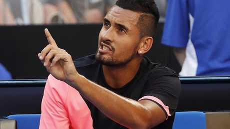 Nick Kyrgios argues with the chair umpire between games after being giving a code violation. Picture: Michael Klein
