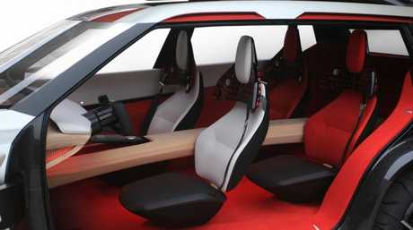 "A wooden ""bridge"" separates the seats in the Nissan Xmotion concept. Picture: Supplied."