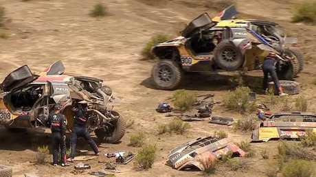 Peterhansel's car struck a rock after avoiding a quad bike on Stage 7.