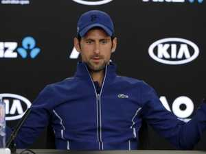 Novak Djokovic gestures during a press conference at the Australian Open.
