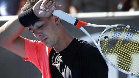 The pressure shows on Thanasi Kokkinaki, who wipes away sweat from his forehead. Picture: David Caird