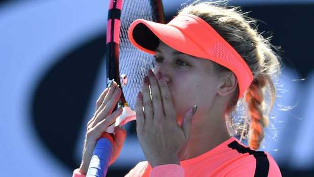 Canada's Eugenie Bouchard celebrates her victory against France's Oceane Dodin in the Australian Open first round.