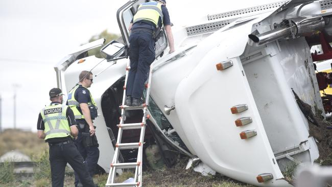 Police and VicRoads inspect the truck. Truck loaded with chickens crashed on Melbourne Road, North Geelong. Picture: Alan Barber