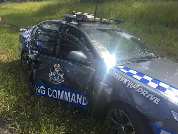 A vehicle has reportedly collided with a police car on the Bruce Highway.
