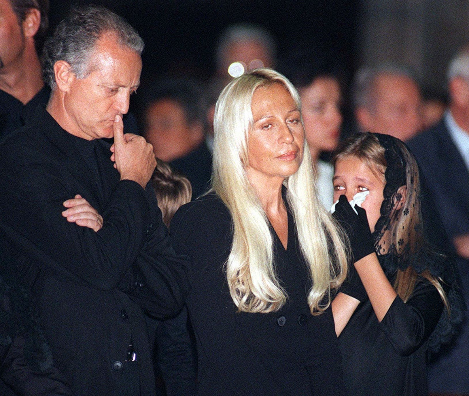 Santo Versace, left, his sister Donatella and her daughter Allegra take part in a memorial for their brother and uncle, slain Italian fashion designer Gianni Versace, at the memorial mass inside Milan's gothic cathedral Tuesday, July 22, 1997.  (AP Photo/Luca Bruno)