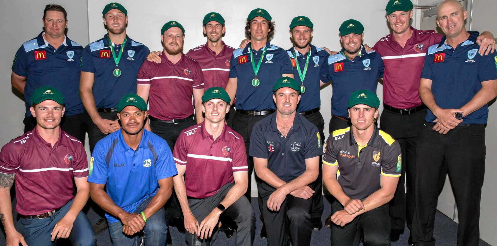 BAGGY GREEN: Sam Lowry (front row, middle) and Jason Seng (back row, fourth from left) with their teammates selected for the ceremonial Australian Country side.