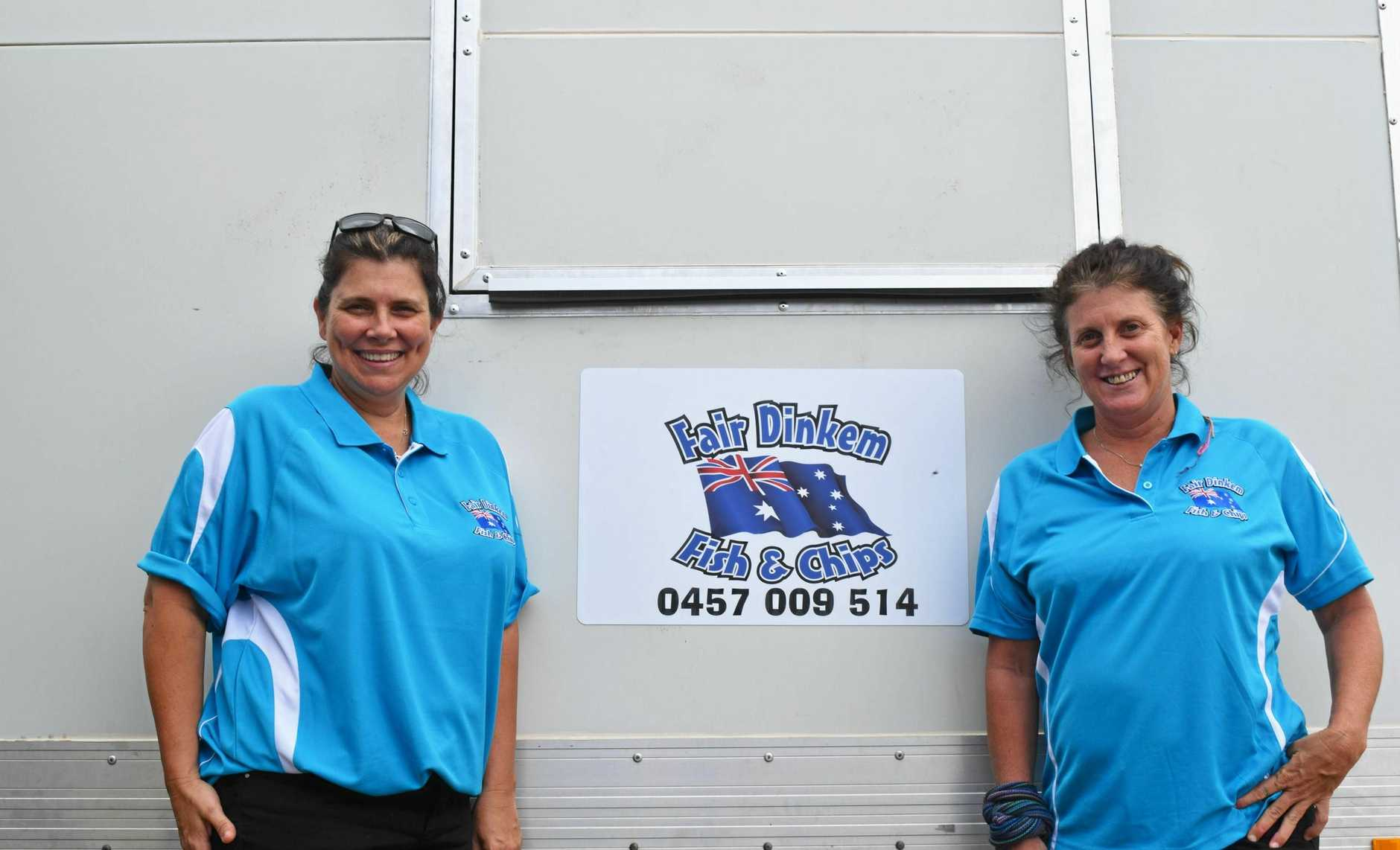 ABOVE, GONE TRUCKIN: Kellie Anderson and Stacey Hober in-front of their new fish and chip food truck.