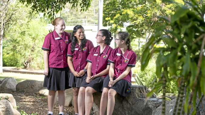 SUCCESS: Nethmini Alahakoon (second from left) with fellow captains during her time at Toolooa State High School. Jasmine Elliott (right) has also been nominated for a Queensland Young Achiever Award.