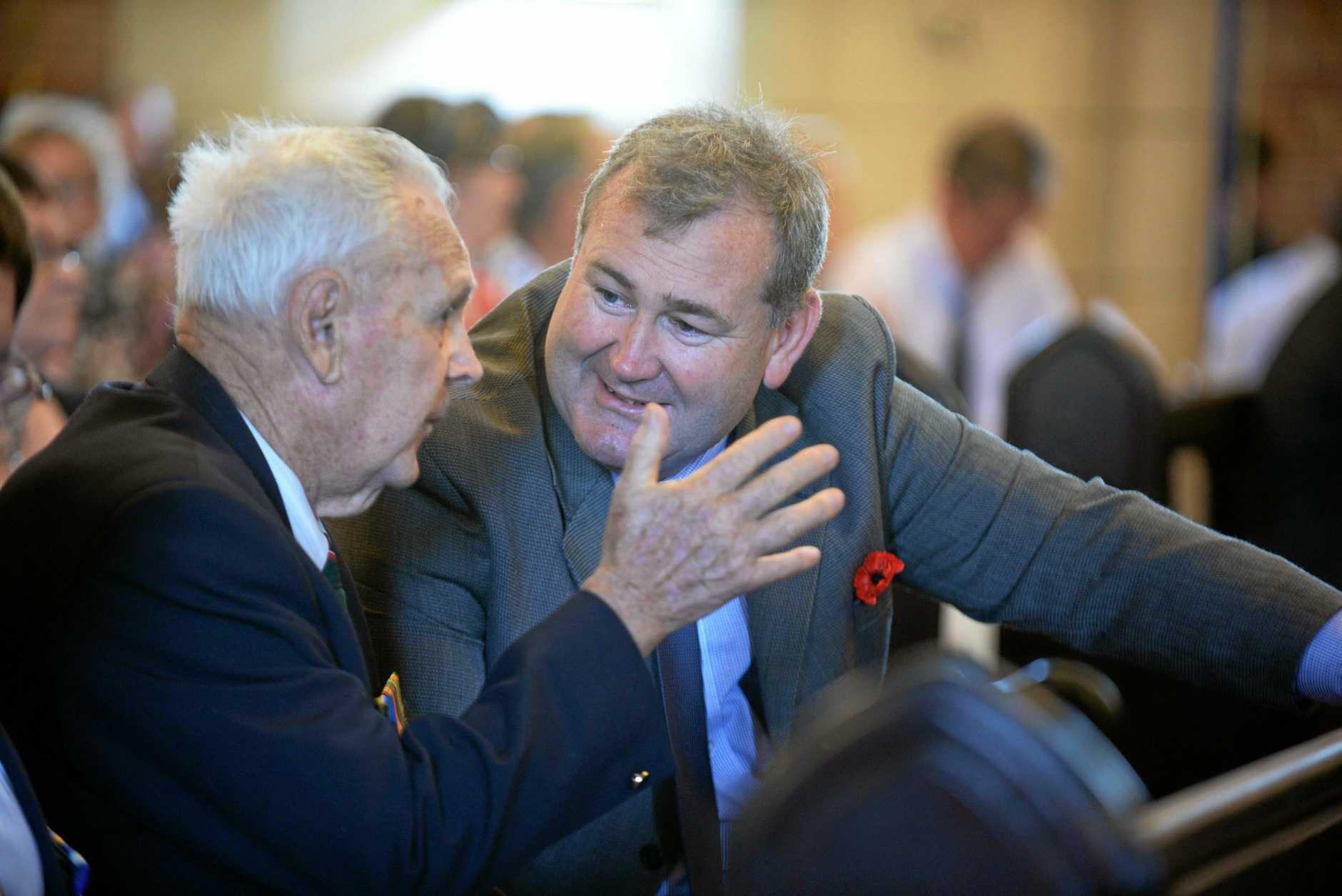 SERVICE: Tom McLucas OAM BEM talks to Mayor Jack Dempsey. RIGHT: Tom Lucas.