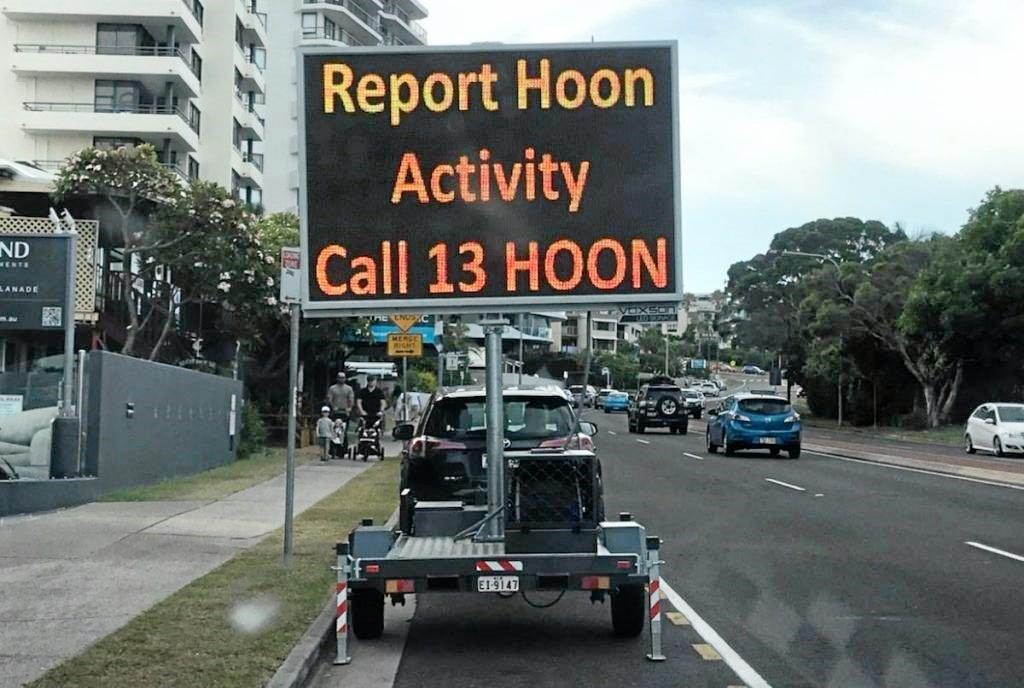 The sign urging residents to report hoons in Mooloolaba.