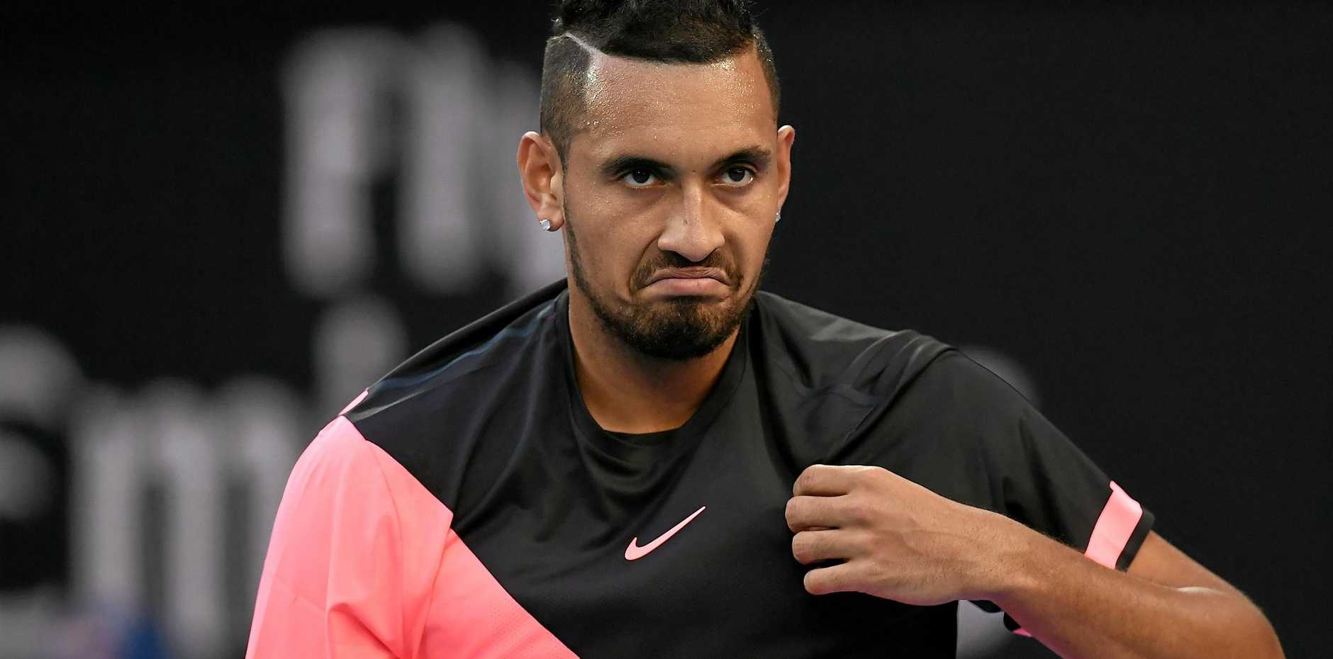 Nick Kyrgios reacts during his opening-round match at the round Australian Open.