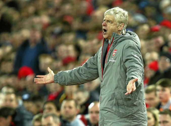 Arsene Wenger reacts to a referee's decision.