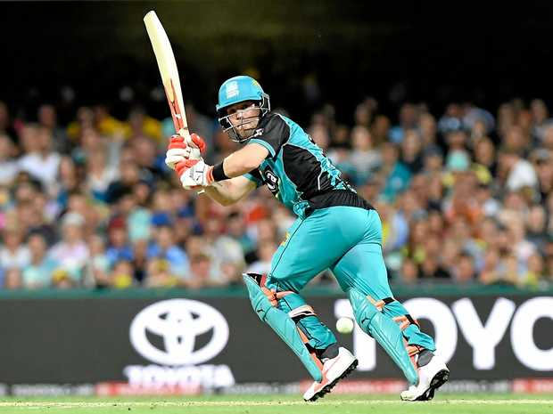 Jimmy Peirson sets off for a run during a BBL game at the Gabba.