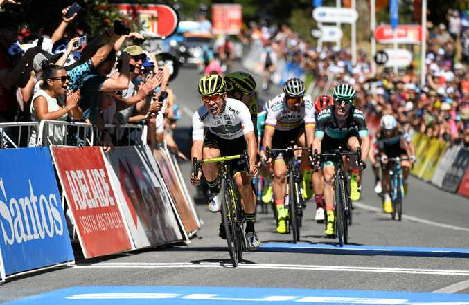 SO CLOSE: Maryborough's Jay McCarthy (BORA-hansgrohe, right) watches on alongside teammate and world champion Peter Sagan (centre) as Mitchelton-Scott rider Caleb Ewan wins stage two. McCarthy finished third.