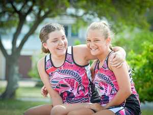 BUDGIES BOUND: Kaniesha Sailor, 16 and Charlize Crawford, 11, will head south in July to represent the Australian Indigenous Budgies team at the Gold Coast Netball Carnival.