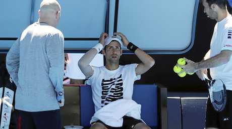 Novak Djokovic with coaches Andre Agassi (left) and Radek Stepanek in Melbourne.