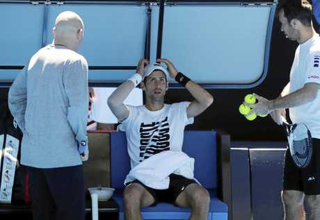 Novak Djokovic with coaches Andre Agassi (left) and Radek Stepanek in Melbourne.