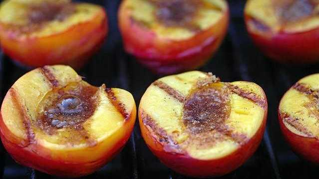 Barbeque peaches are delicious served with ice cream and cream.