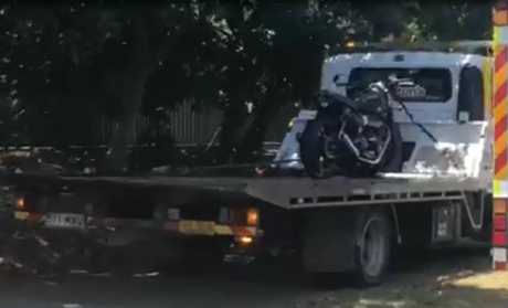 The motorbike was loaded onto a tow truck after it crashed at the intersection of Kawana Way and Kawana Island Boulevard.