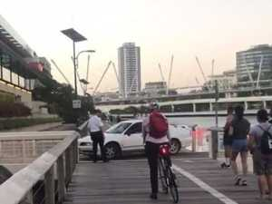 Pedestrians flee car on boardwalk