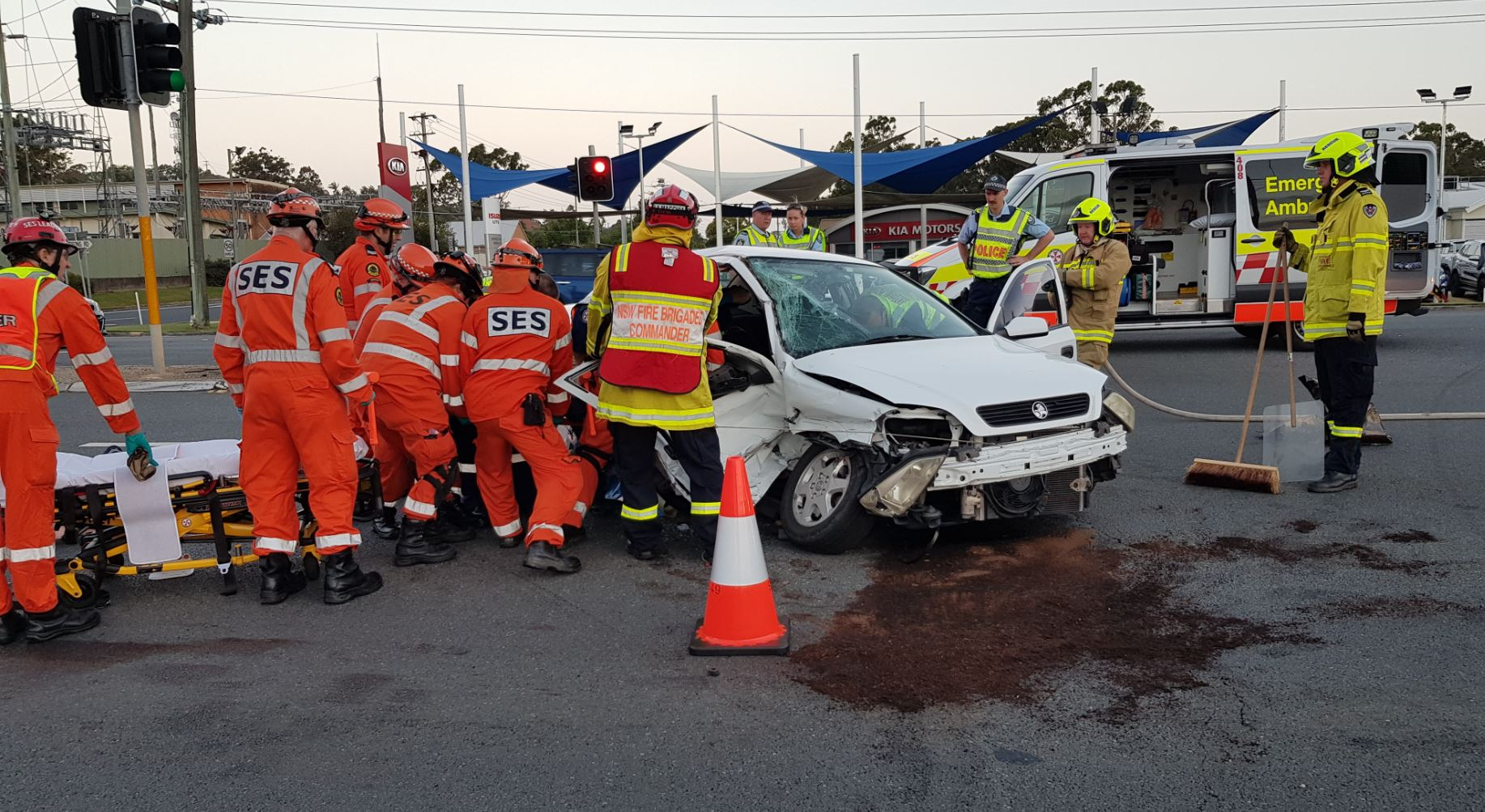 The woman was left unconscious and trapped in a Holden Astra after a crash with a Nissan Navara towing a horse float on the Pacific Highway south of the Coffs Harbour CBD.