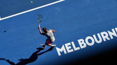 Unusual tactics as Rafael Nadal plays a forehand return from well behind the baseline to Leonardo Mayer. Picture: AFP
