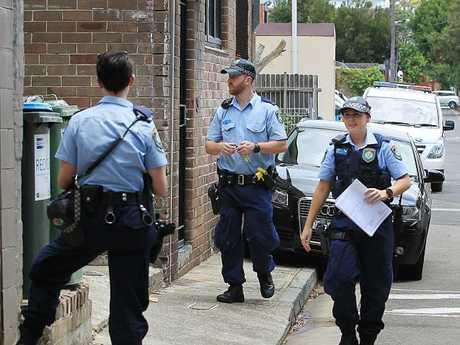 Police investigating near the unit.