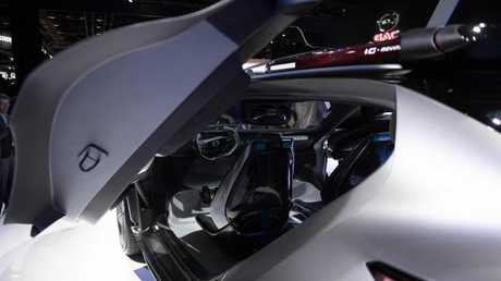The interior looks like the cockpit of a plane. A pod on the roof houses a Segway scooter. Picture: AFP PHOTO, JIM WATSON.