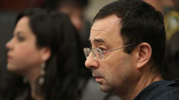 Larry Nassar sits with his lawyer Shannon Smith as victim impact statements are read in court before he is sentenced for molesting girls while he was a doctor for USA Gymnastics. Picture: AP