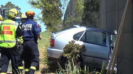 The car was embedded in the fence. Pictures: 9 News (supplied)