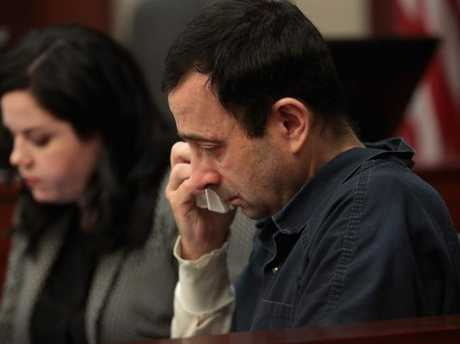 Larry Nassar wipes a tear as he listens to a victim impact statement by Jennifer Rood Bedford at his sentencing hearing.