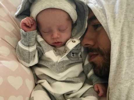 Enrique Iglesias cuddles up to one of his twins. Picture: Instagram
