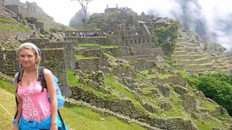 Natalie explores Machu Picchu during her travels.