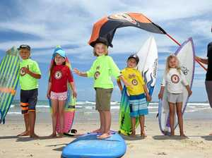SURF'S UP: Junior surfers Tommy Horne, Samantha Arderne, Slade Phillips, Joel Maritz and Soraya Phillips with Snapper Rocks Surfriders Club president Jay Phillips are looking for more junior members to join their ranks.