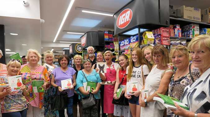 GOOD GRUB IDEAS: Kim McCosker (centre) IGA owners Cheryl and Bart Derlagen (rear) and shoppers at IGA Outlook.