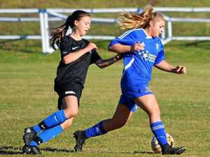 BEND IT LIKE BECKHAM: Women's premier division players Lola Neale from Bangalow Soccer Club and Caitlin Moss from Lismore Thistles Soccer Club battle for possession during the top of the table clash on Sunday won by Thistles 1-0""