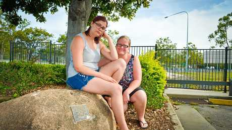 HEARTBROKEN: Caitlin and Amanda Pugh have been trying to clean the plaque (inset) dedicated to their father, who passed away two years ago, after it was graffitied on Tuesday.