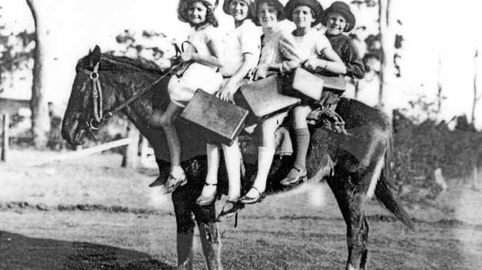 Children riding horse back to school at Glass House Mountains in 1928.