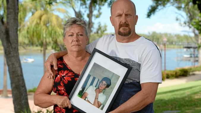 DEVASTATED: L-R Niece Kerry Rothery and son Mick Valigura with a framed photo of Janice Valigura nee Rothery who was allegedly placed in a pine coffin by a funeral director after the family had purchased an expensive casket.