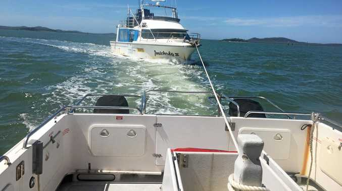 SLOW TOW: The boat (pictured) was towed from Polmaise Reef on Sunday, January 14 by VMR Gladstone. The tow took six hours.