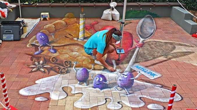FUN FOR KIDS: Amelia Batchelor doing chalk art in the main street during the last Apple and Grape Festival.