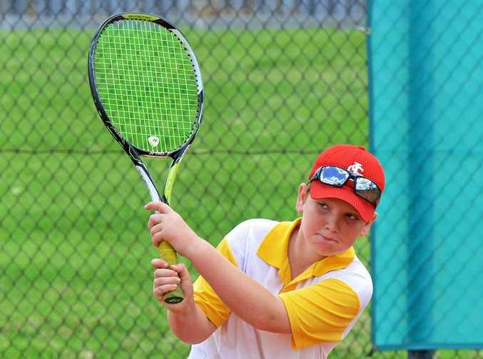 BACKHAND: Jacob Stenzel, 10, at a recent Hot Shots clinic at George Alder Tennis Centre.