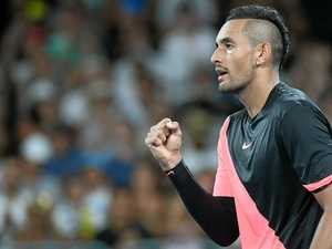 Nick Kyrgios celebrates his win against Viktor Troicki.