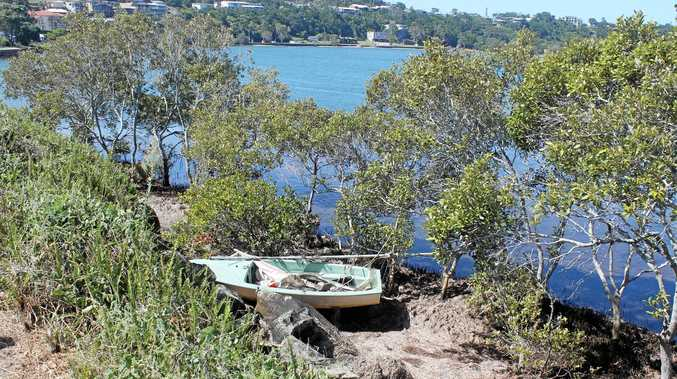 GHOST SHIP: This abandoned sailing dinghy has been floating around Shaws Bay for about six months.