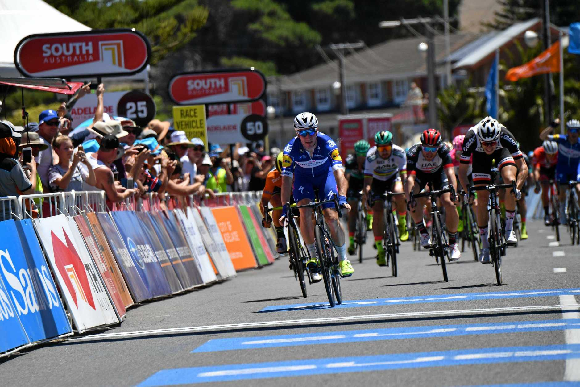 Italian rider Elia Viviani wins stage three of the Tour Down Under from Glenelg to Victor Harbor, South Australia. Maryborough's Jay McCarthy, pictured off Viviani's shoulder in the background, finish the stage tenth overall.