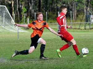 Football, Maryborough - Granville versus Tinana.  Tinana's Caleb Simpson outruns the defense.