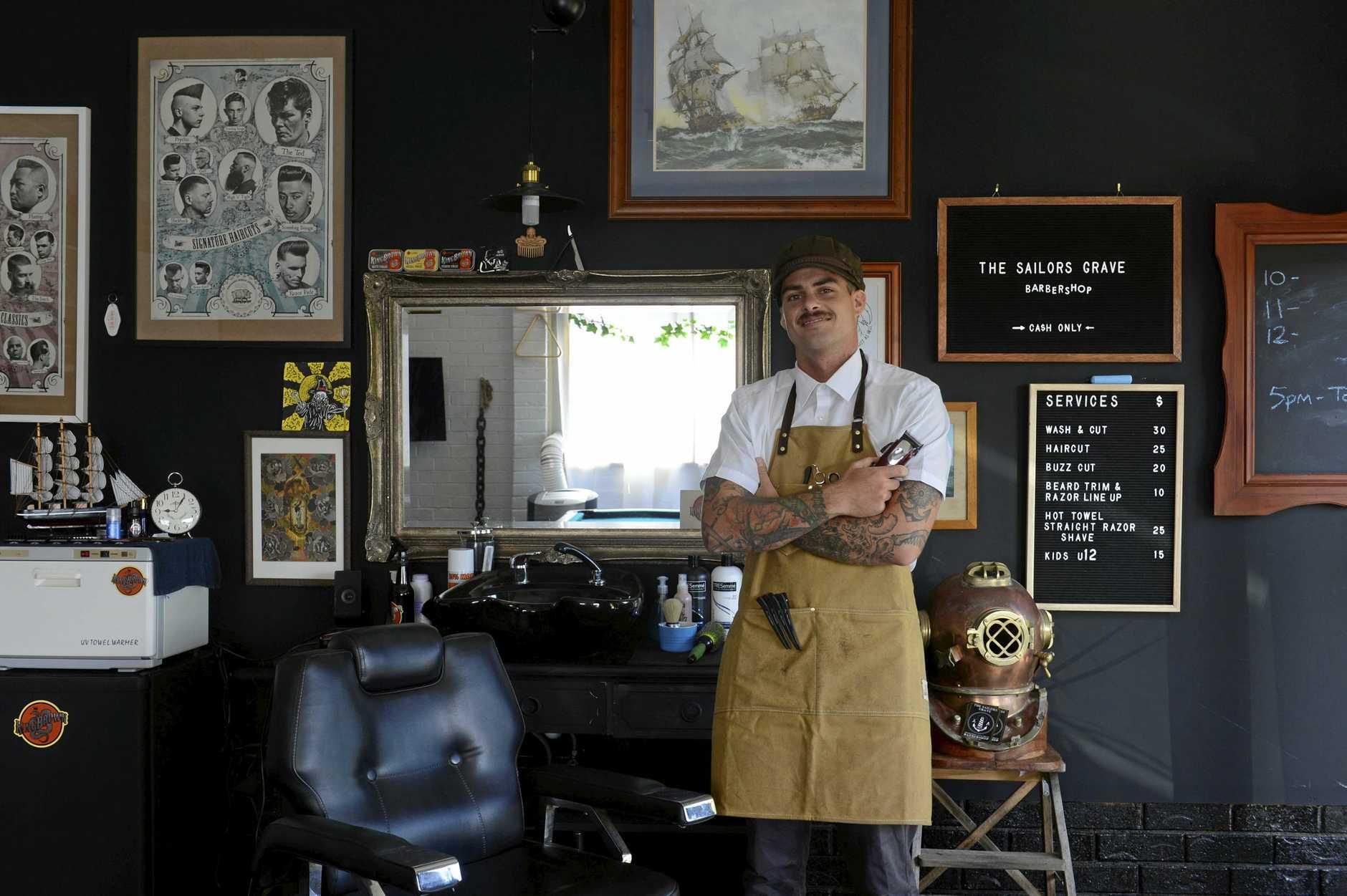 FRESH CUT: Jesse Rhynard sweet set up at his Yamba barbershop includes a few vintage pieces.